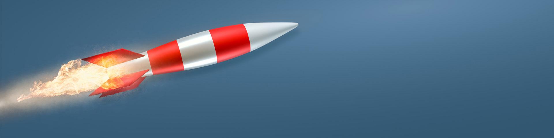 Rot/grau gestreifte Rakete vor dunklem Hintergrund